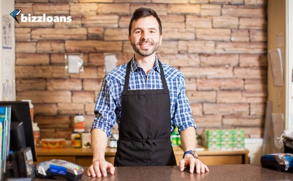 business owner smiling at the checkout counter