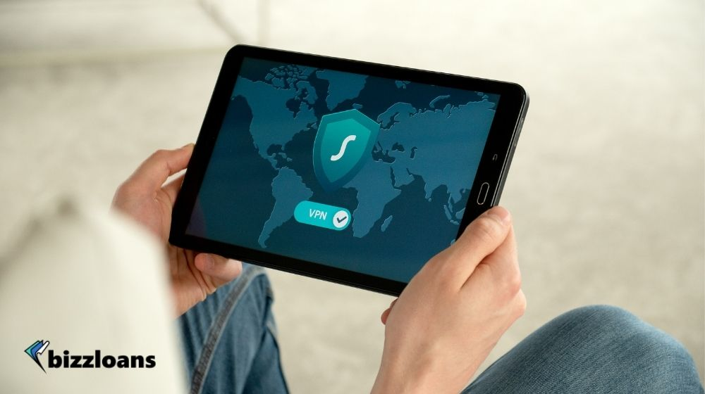 man holding a tablet displaying VPN
