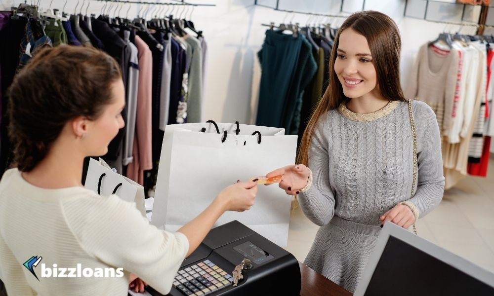 Happy female Customer Paying with Credit Card