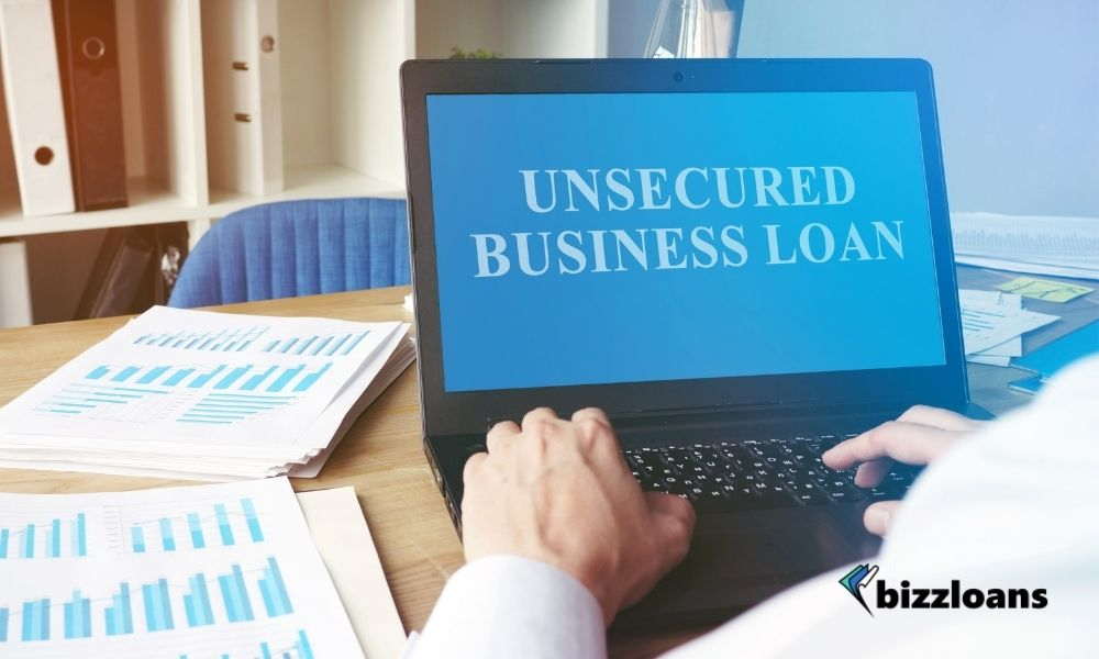 man using his laptop displaying unsecured business loan